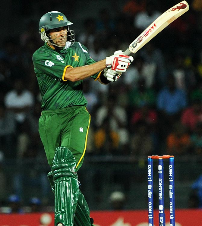 Pakistan cricketer Umar Gul hits a six. -Photo by AFP