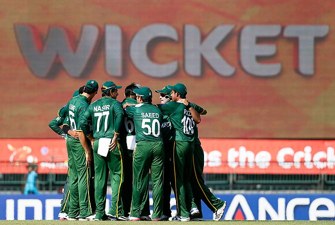 Pakistan's cricketers celebrate the dismissal of South Africa's Hashim Amla. -Photo by AP