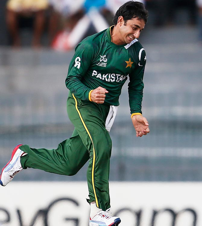 Pakistan's bowler Saeed Ajmal celebrates the dismissal of South Africa's Richard Levi. -Photo by AP