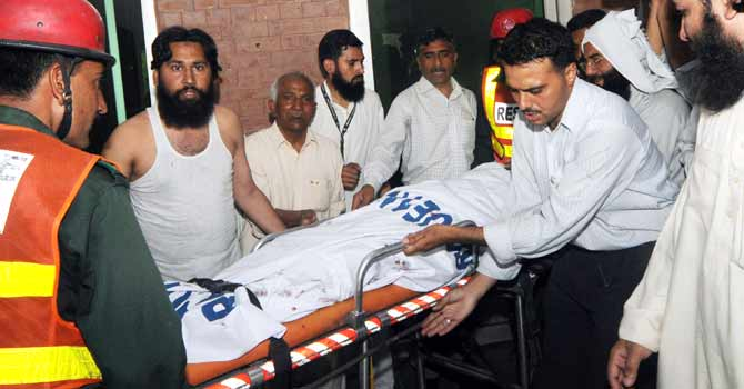 Rescue officials at a government hospital in Lahore. – File photo by AFP