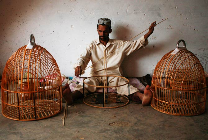 A man makes bird cages at a workshop. ? Photo by Reuters