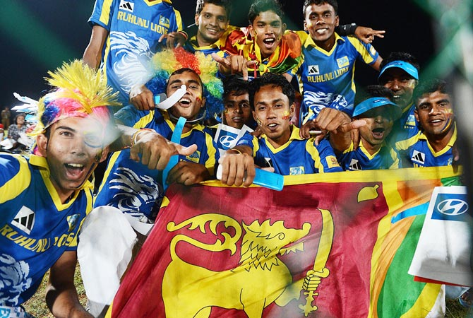 Sri Lankan fans cheer during the match. -Photo by AFP
