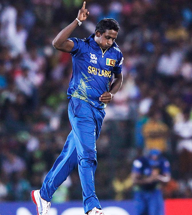 Sri Lanka's Ajantha Mendis celebrates taking the wicket of Zimbabwe's Elton Chigumbura. -Photo by Reuters