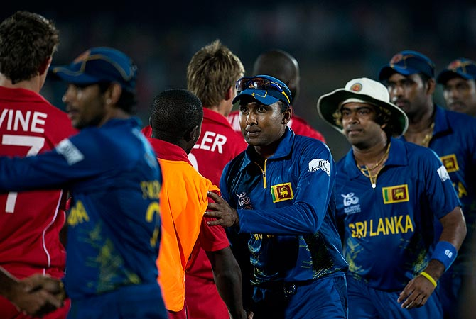 Sri Lanka's cricketers from left, Tillakaratne Dilshan, captain Mahela Jayawardena, and Lasith Malinga, shake hands with Zimbabwe's cricketers after Sri Lanka beat Zimbabwe by 82 runs. -Photo by AP