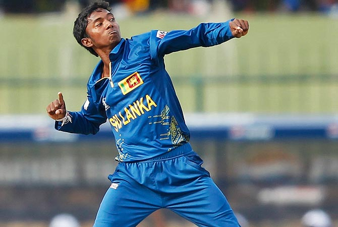 Sri Lanka's Akila Dananjaya celebrates after taking the wicket of New Zealand's Martin Guptill. -Photo by Reuters