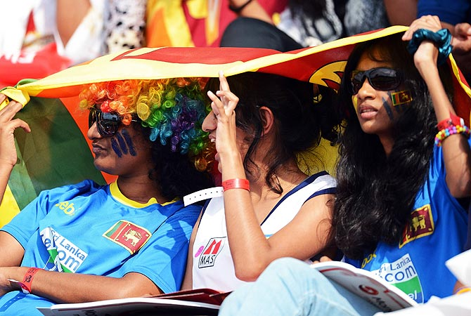 Sri Lankan cricket fans look on during the match. -Photo by AFP