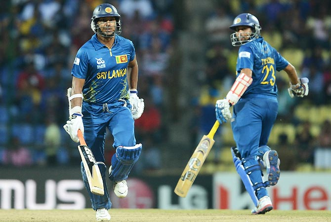 Kumar Sangakkara (L) and Tillakaratne Dilshan run between the wickets. -Photo by AFP