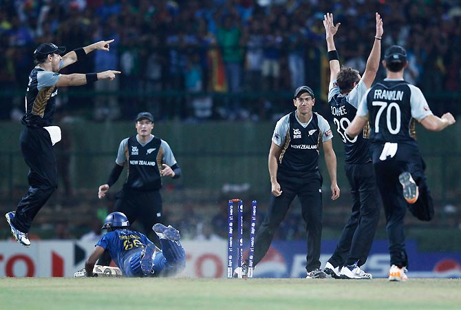 New Zealand's players successfully appeal for the wicket of Sri Lanka's Lahiru Thirimanne. -Photo by Reuters
