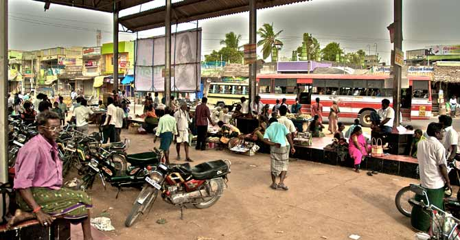 People wait to board buses on a highway in Sivagangai district, Tamil Nadu. — File photo courtesy Creative Commons