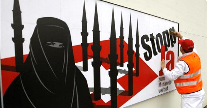 A referendum campaign poster supporting the minaret ban, in Zurich in 2009. - File photo by Reuters
