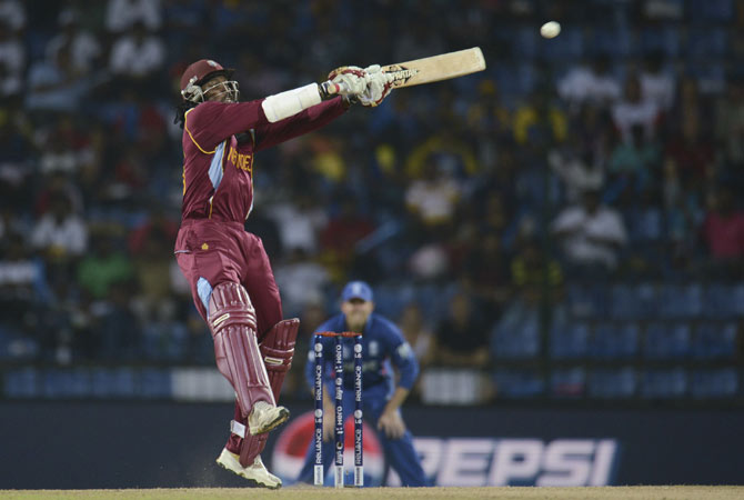 West Indies' Chris Gayle hits a four from the bowling of England's Steven Finn.