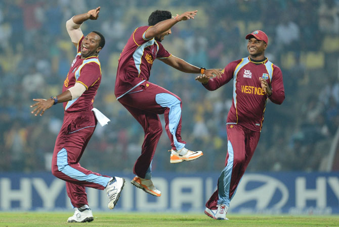 West indies bowler Ravi Rampaul (C) celebrates the wicket of England cricketer Craig Kieswetter with teammates.