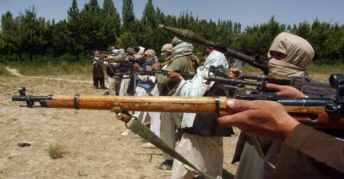 Taliban fighters train with their weapons in an undisclosed location in Afghanistan – File photo by Reuters