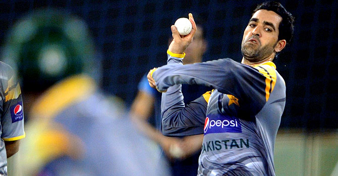 Umar Gul bowls during a practice session – Photo by AFP