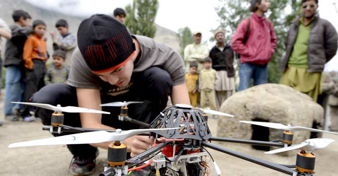 In this July 2012 photo provided by Footloose Fotography, a team member prepares to fly a radio-controlled helicopter at the base of Trango Summit in the Karakoram mountain range in northern Pakistan. — Photo by AP