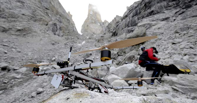 In this July 2012 photo provided by Aurora Photos for Mammut, a team member gets ready to operate a helicopter over the Trango Summit in northern Pakistan's Karakoram mountain range. – Photo by AP