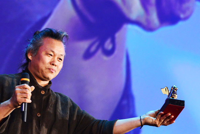 Korean film director Kim Ki-Duk holds the Golden Lion for best movie during the award ceremony of the 69th Venice Film Festival on September 8, 2012 at Venice Lido. South Korean director Kim Ki-duk's morality tale ?Pieta? won the Golden Lion for best movie at the Venice film festival.