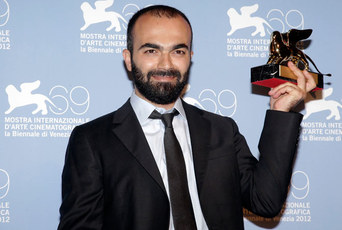 Director Ali Aydin holds the trophy for the Lion of the Future - ?Luigi De Laurentiis? Award.