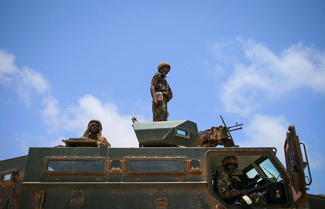Soldiers serving with the Kenyan Contingent of the African Union Mission in Somalia (AMISOM) are seen atop an armoured personnel carrier in the grounds of Kismayo University in the southern Somali port city of Kismayo, approx. 500km south of the country's capital Mogadishu.