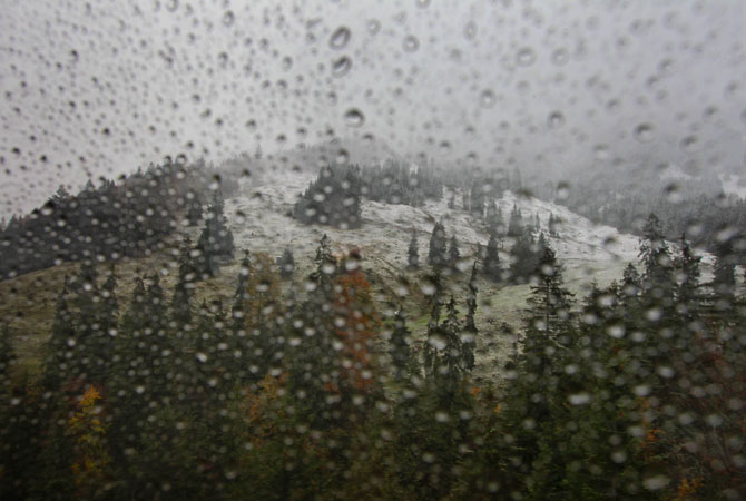 The landscape around the Nebelhorn mountain is partly covered in snow, seen through the rain-sprinkled window of a funicular near Oberstdorf, southern Germany. ? Photo by AFP