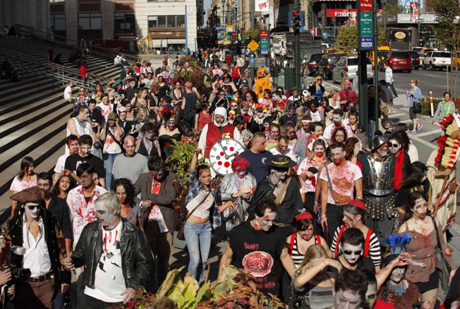 "People dressed up as zombies walk on a street in New York. Hundreds of people took part in the event known as ""ZOMBIECON"" during Halloween celebrations and to pay homage to the character typically depicted as the mindless walking dead with a penchant for human flesh and brains, made popular in movies, books and comics.?Reuters Photo"