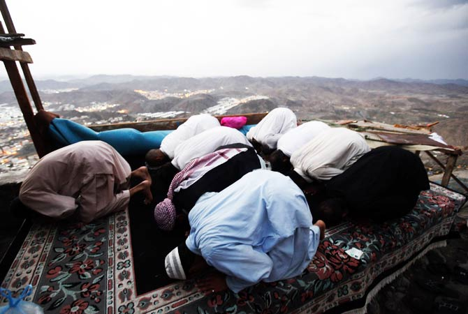 Muslims pray at the top of Mount Noor. ? Photo by Reuters