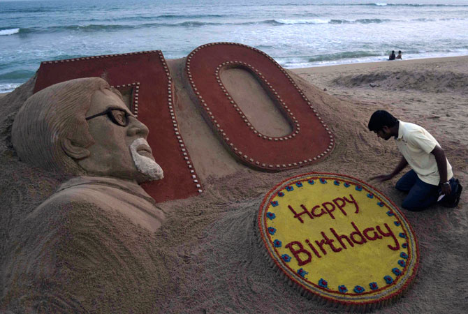 Indian sand artist Sudarshan Pattnaik applies the finishing touches to a sand sculpture of Bollywood's biggest star Amitabh Bachchan a day ahead of his 70th birthday, at the beach in Puri, India, Wednesday. ? Photo by AP