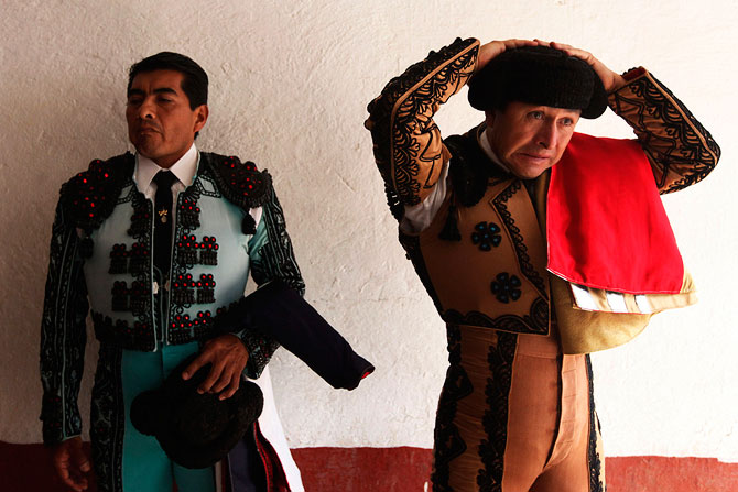 A Mexican banderillero adjusts his montera before the start of a bullfight at La Mexico bullring in Mexico City September 16, 2012. A legislative initiative to ban bullfighting in the country's capital has stalled since April due to a lack of consensus among the seven political parties. Launched last year by the Ecologist Green Party of Mexico (PVEM) and supported by the country's animal rights groups, the initiative is a direct result of Catalonia's ban of the sport in 2010.