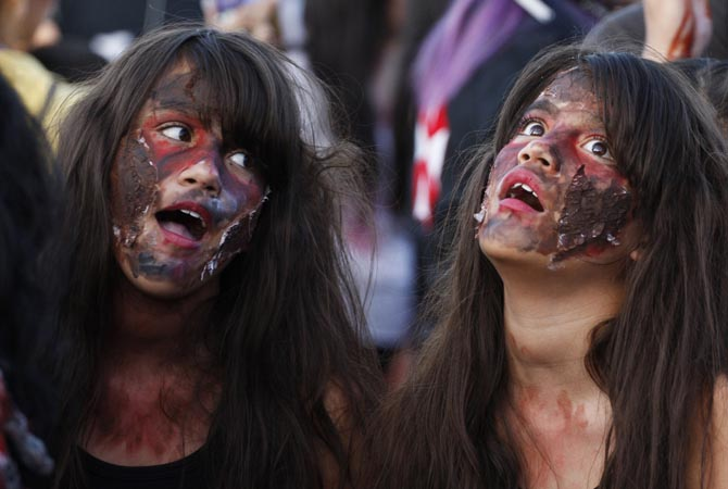 "Girls dressed up as zombies participate in a ""zombie walk"" in Ciudad Juarez .?Reuters Photo"