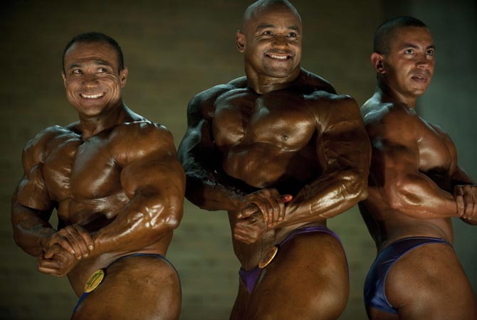 Participants strike a pose as they compete in the Mr Antioquia Bodybuilding and Fitness Championship in Medellin. Participants, who darken their skin with tanning products and apply oils to increase shine, do a series of mandatory poses and display their best shaped muscles to a panel of judges who assign points based on their appearance.?AFP Photo
