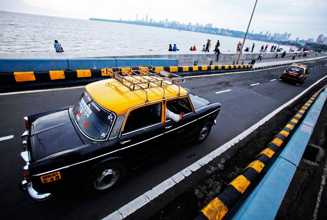 A Premier Padmini taxi travels along Marine Drive in Mumbai. ? Photo by Reuters