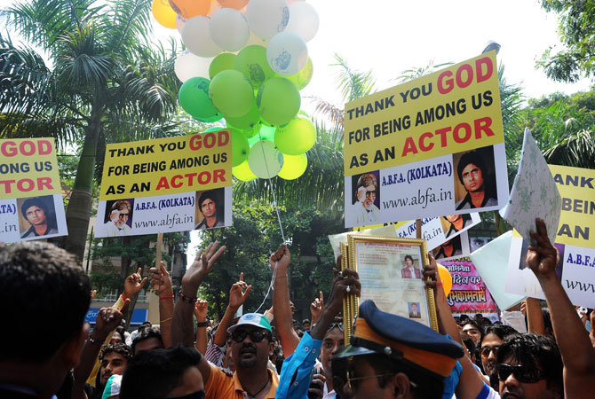 Fans of Indian Bollywood actor Amitabh Bachchan gather outside his residence on his 70th birthday in MumbaI. India's favourite film star and Bollywood legend, Bachchan - who is known as the ?The Big B? having over 3.5 million Twitter followers is treated like royalty in the movie-mad country. ? Photo by AFP