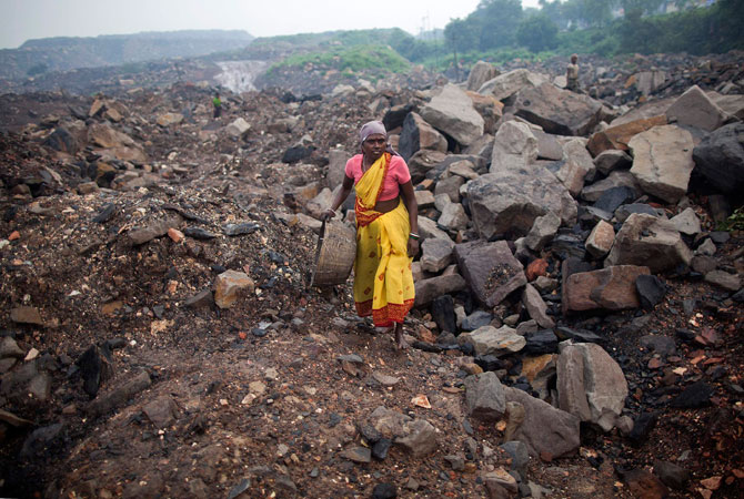 A local woman prepares to collect coal from an open cast coal field at Dhanbad district in the eastern Indian state of Jharkhand.