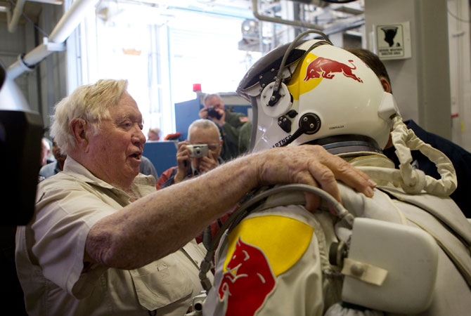 In this Nov. 8, 2011, photo provided by Red Bull Stratos, retired U.S Air Force Col. Joe Kittinger, left, and pilot Felix Baumgartner of Austria greet each other during the Brooks chamber test for Red Bull Stratos. The Red Bull Stratos team brings together the world's leading minds in aerospace medicine, engineering, pressure suit development, capsule creation and balloon fabrication. ? Photo by AP