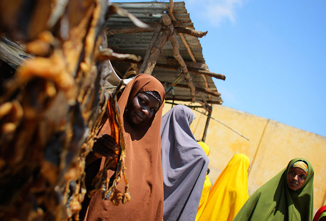 A Somali woman sells dried fish from a kiosk in a market area in the centre in Kimayo after African Union troops seized the town from the Al-Qaeda linked Al-Shabaab group.