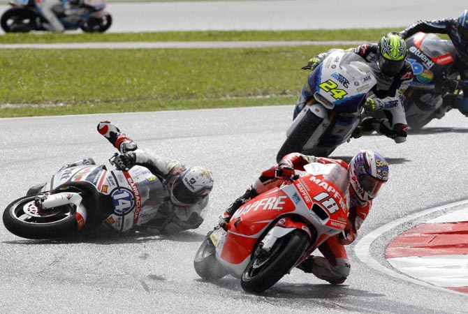Moto2 rider Ratthapark Wilairot of Thailand falls during Malaysian Motorcycle Grand Prix in Sepang, Malaysia.?AP Photo