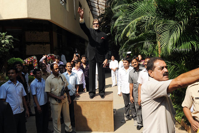 Bollywood star Amitabh Bachchan greets fans gathered outside his residence on his 70th birthday in Mumbai on October 11, 2012.   Bachchan was the first Indian actor to feature at London's Madame Tussauds waxworks museum and was voted ?actor of the millennium? in a BBC online poll in 1999. ? Photo by AFP