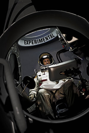 Pilot Felix Baumgartner of Austriasits in his capsule during the preparations for the final manned flight of the Red Bull Stratos mission in Roswell, New Mexico. ? Photo by AFP