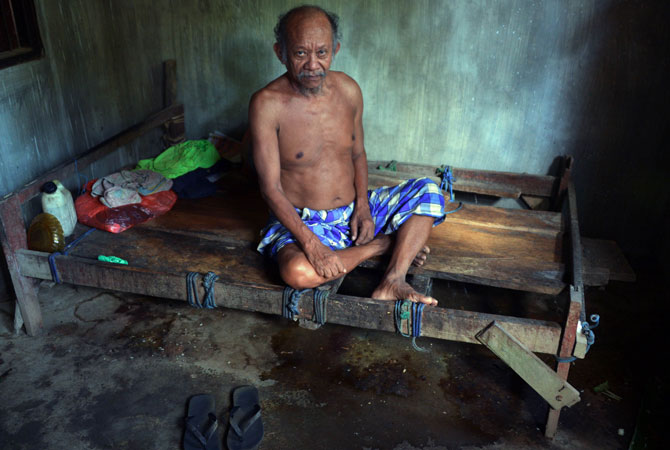 A mental disorder patient, Nengah Surung, 65, stays in his special room which design for his illness in Karangasem. This event promotes open discussions on illnesses, as well as investments in prevention and treatment services.