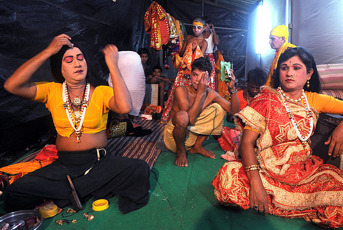 Indian male artists Ram Vilas (L) and Dev Narayan, both portraying female characters  prepare for a show backstage at the Maharashtra Ramlila Manch in Mumbai.