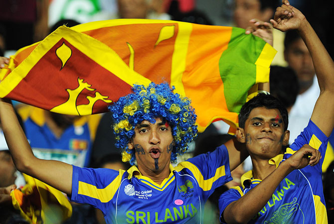Sri Lanka fans cheer for their team before the start of the match. -Photo by AFP