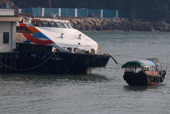 A damaged ferry is docked at a pier after colliding with a boat in Lamma Island, off the southwestern coast of Hong Kong. ? Photo by AP