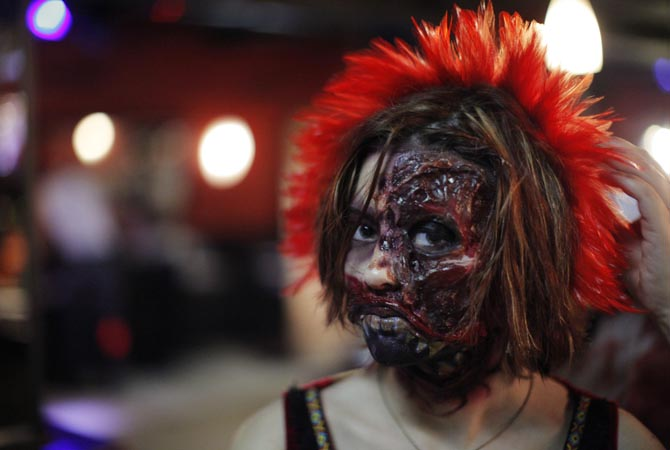 A woman dressed up as a zombie poses for a picture during an event in New York.?Reuters Photo