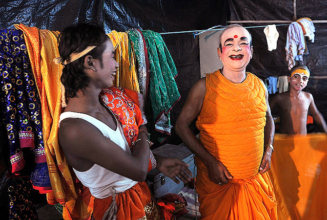 Indian junior artists joke with Laxmi Narayan Jha, 77, affectionately known as ?Grandpa? as they prepare for a show backstage at the Maharashtra Ramlila Manch.