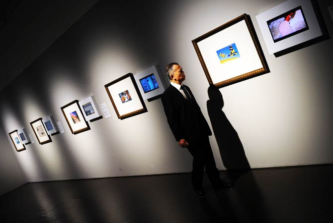 A man looks at the displayed works at the preview visit to The China Art Museum in Shanghai. ? Photo by AFP
