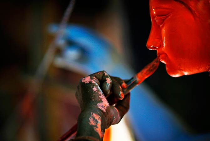 An artist paints idols of Hindu warrior goddess Durga, who destroys demons to prevail over evil. ? Photo by AP