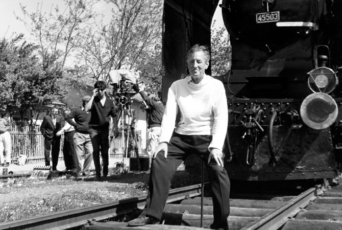 "In this June 23, 1963 file photo, British writer Ian Fleming, author of the James Bond spy thrillers, sits in front of a Turkish train, as a gag, during a visit to the set of the film ""From Russia With Love"" in Istanbul, Turkey. Fleming, a former World War II intelligence officer, created 007 as a sort of fantasy alter-ego."