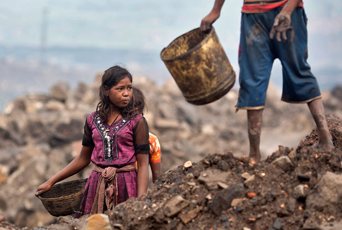 Locals prepare to collect coal from an open cast coal field at Dhanbad district in the eastern Indian state of Jharkhand.