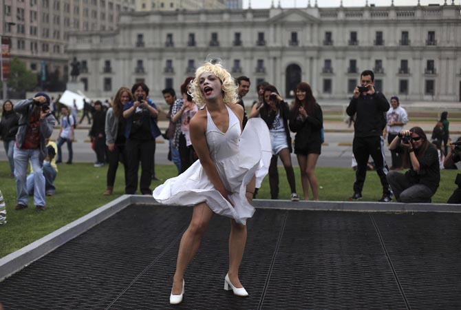 "A participant dressed as US actress Marilyn Monroe takes part in the ""Zombie Walk"" in downtown Santiago.?Reuters Photo"