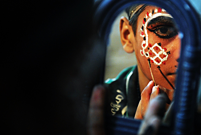 Young Indian artist Ajay Kumar, 15,  prepares for a show backstage at the Maharashtra Ramlila Manch.